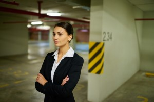 Businesswoman in underground car park