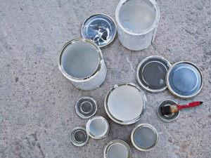 Paint cans and paintbrush
