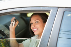 Woman holding keys to new car