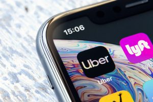 Uber and Lyft logos on a phone