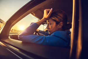 Exhausted woman driving