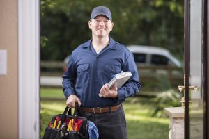 Repairman at a home's door.