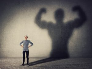 person standing with shadow of strong person