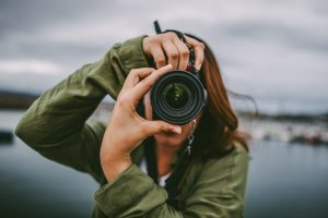 A female photographer taking a picture.