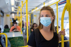 Woman wearing a mask on a bus