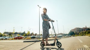 Young woman on an electric scooter