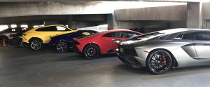 Line of Lamborghinis in a parking garage
