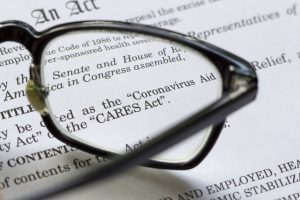 pair of glasses on a printed copy of the CARES Act
