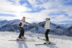 Woman having ski lesson on mountain