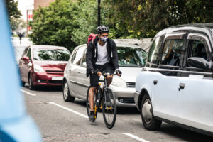 Cyclist commuter wearing a mask.