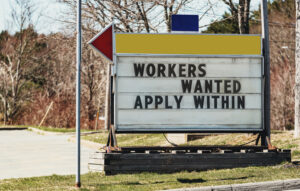 """Sign reading """"Workers Wanted Apply Within"""""""