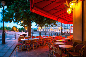 Colorful tables and chairs in sidewalk cafe