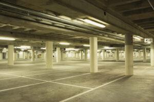 Empty parking garage at night.