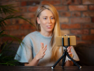 Woman making video with iphone.