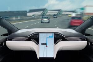 Autonomous car on a road. Inside view.
