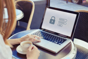 data protection and internet security concept, woman user typing password on computer for secured access