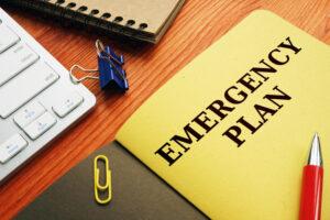 Emergency plan or Disaster Preparedness on the desk.
