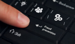 """""""Fraud prevention"""" on a computer keyboard key."""