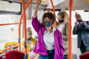 passengers on a bus wearing protective masks during the Covid 19 pandemic.